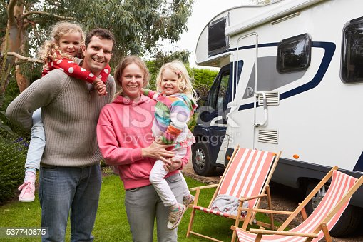 istock Portrait Of Family Enjoying Camping Holiday In Camper Van 537740875