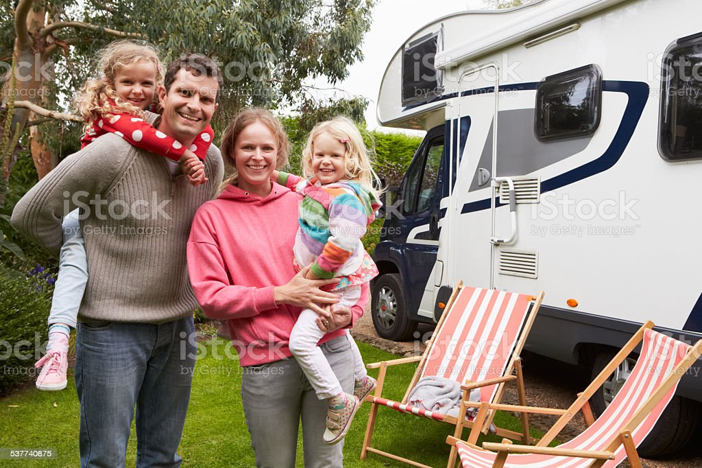 Portrait Of Family Enjoying Camping Holiday In Camper Van stock photo