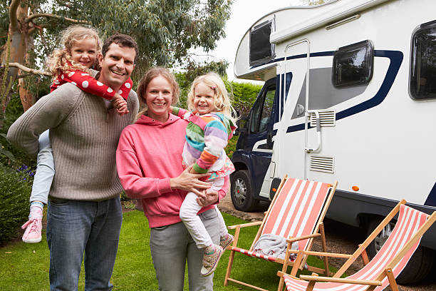 portrait of family enjoying camping holiday in camper van - motorhome stock photos and pictures