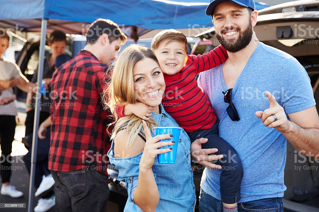 Portrait Of Family Group Tailgating In Stadium Car Park stock photo