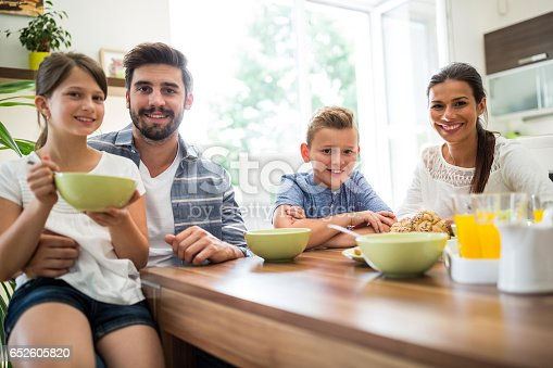 istock Portrait of family having breakfast 652605820