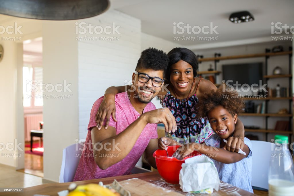 Portrait of family making cookies in the kitchen royalty-free stock photo