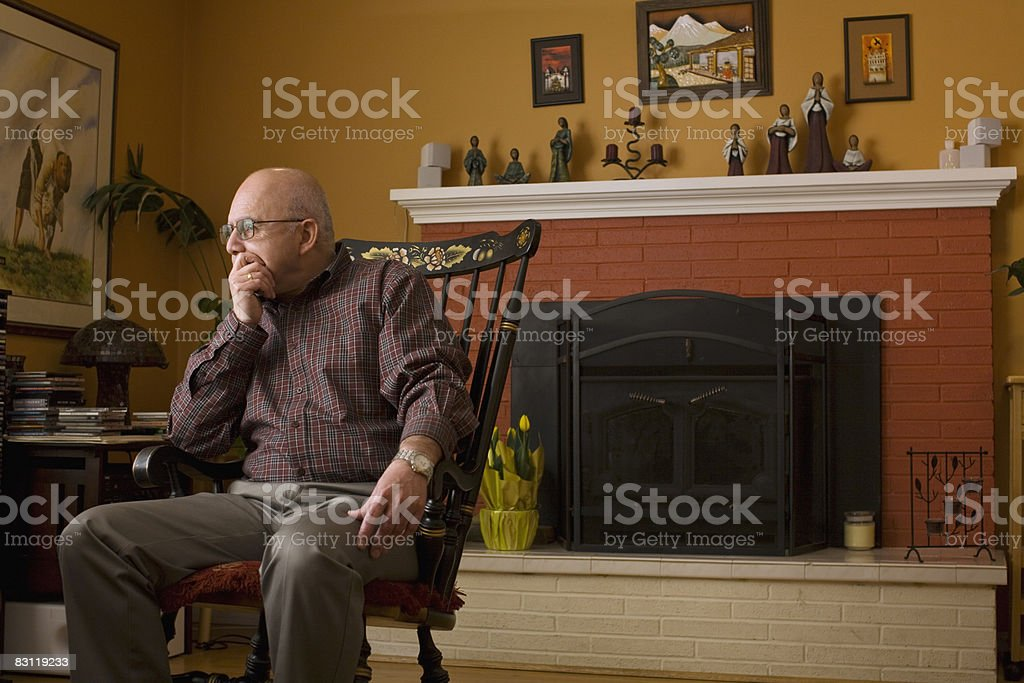 portrait of family patriarch in conversation royalty free stockfoto
