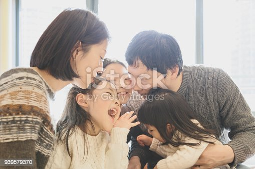 1152545468 istock photo Portrait of family relaxed at home 939579370