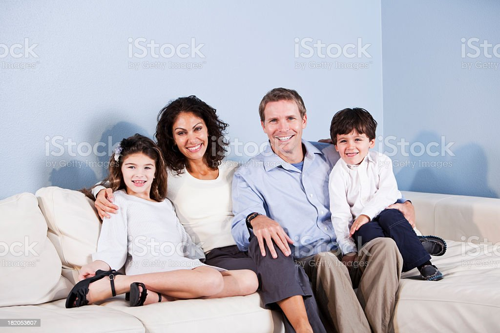 Portrait of family sitting on sofa royalty-free stock photo