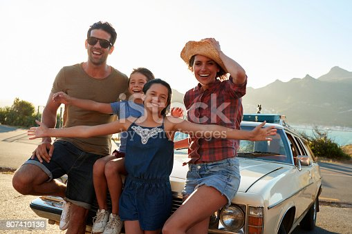 807410158 istock photo Portrait Of Family Standing Next To Classic Car 807410136