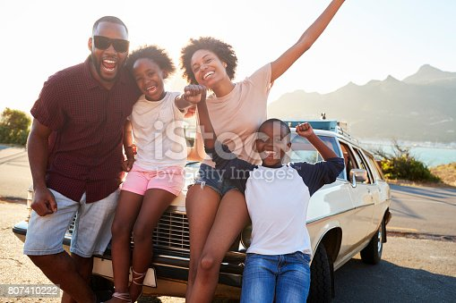 807410158 istock photo Portrait Of Family Standing Next To Classic Car 807410222