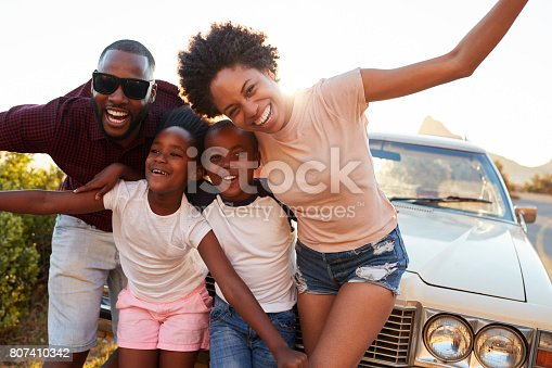 807410158 istock photo Portrait Of Family Standing Next To Classic Car 807410342
