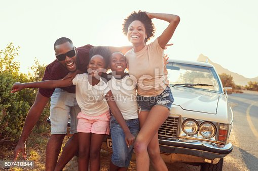 807410158 istock photo Portrait Of Family Standing Next To Classic Car 807410344