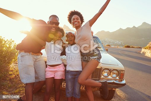 807410158 istock photo Portrait Of Family Standing Next To Classic Car 807410406