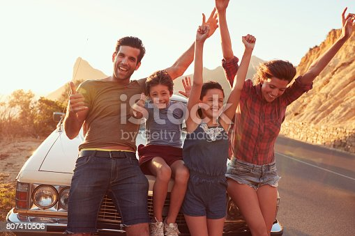 807410158 istock photo Portrait Of Family Standing Next To Classic Car 807410506