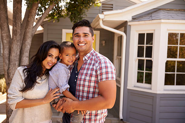 Portrait Of Family Standing Outside Home Portrait Of Family Standing Outside Home latin american and hispanic ethnicity stock pictures, royalty-free photos & images