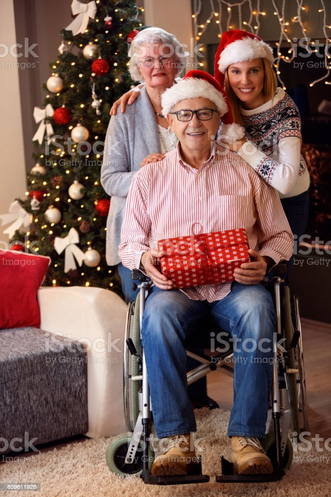 Portrait of family wearing Santa caps on Christmas Eve stock photo