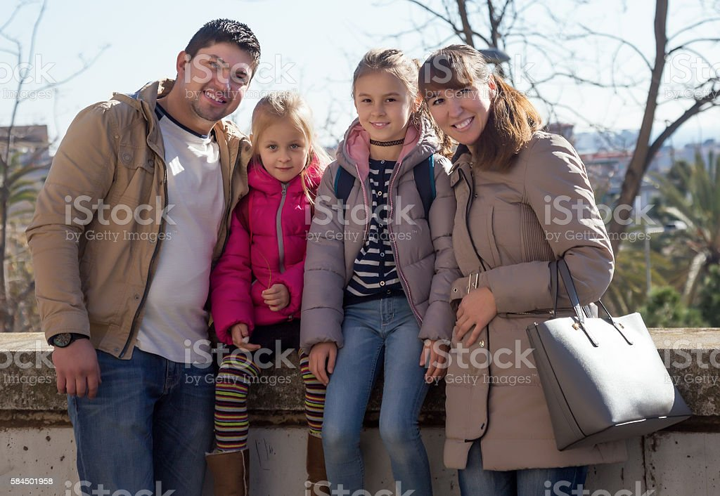 Portrait of family with two girls outdoors – Foto