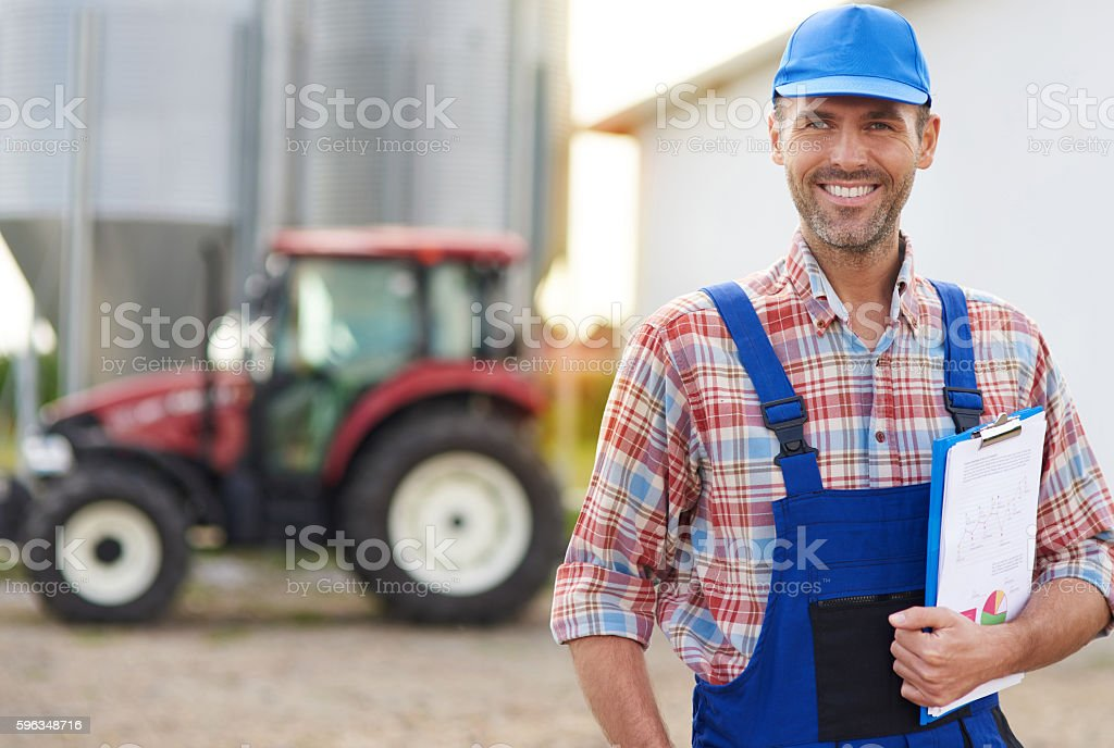Portrait of farmer in front of the barn royalty-free stock photo