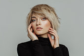 Portrait of fashion blond woman with short hair