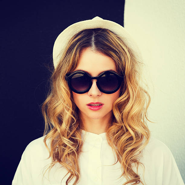 portrait of fashion hipster girl at contrast wall - high contrast stock pictures, royalty-free photos & images