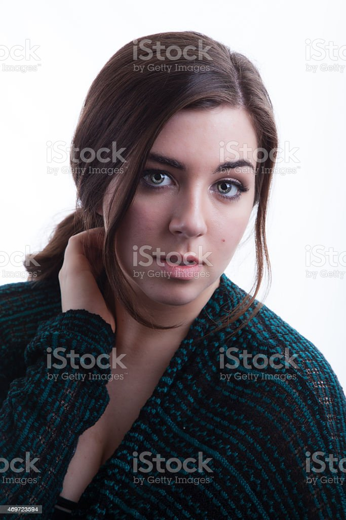 Portrait of Fashion Model Wearing Fall Green Sweater on White stock photo