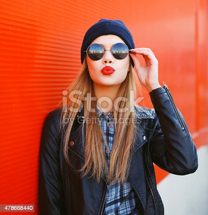istock Portrait of fashionable blonde girl with red lipstick wearing a 478668440