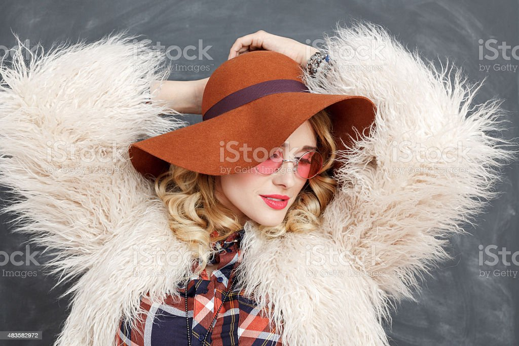 Portrait of fashionable blonde woman in boho style stock photo