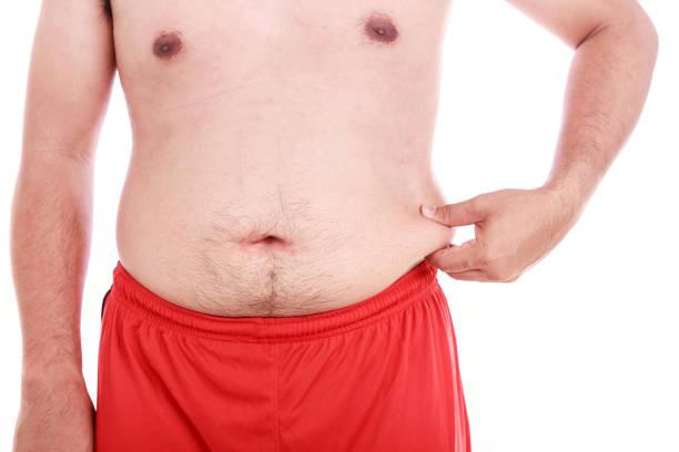 porträt von dicker mann isoliert auf weiss: fett und gesund-konzept - blähbauch medikamente stock-fotos und bilder