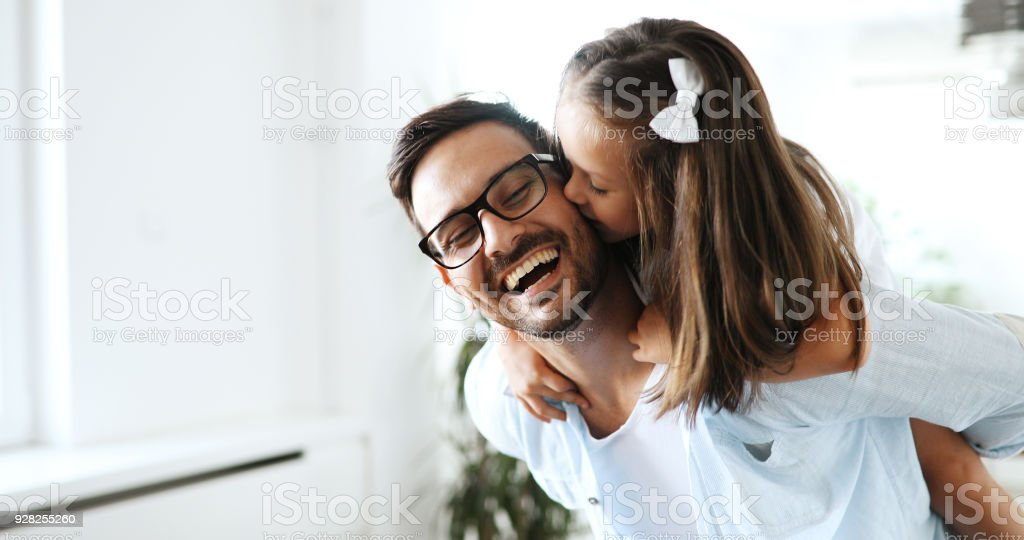 Portrait of father and daughter playing at home stock photo