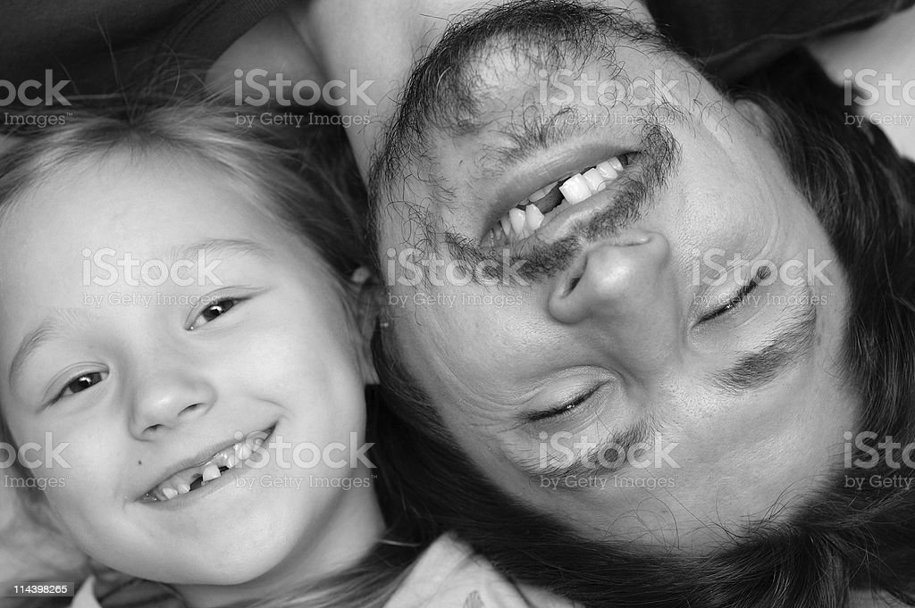 Portrait of father and daughter without a tooth stock photo