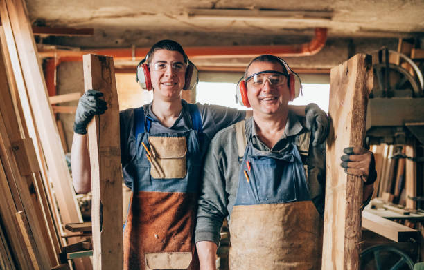 portrait of father and son carpenters - violetastoimenova stock photos and pictures