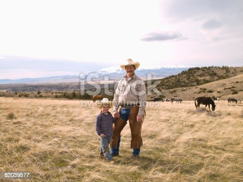 Father and son on range in Big Timber, Montana checking horses health on ranch