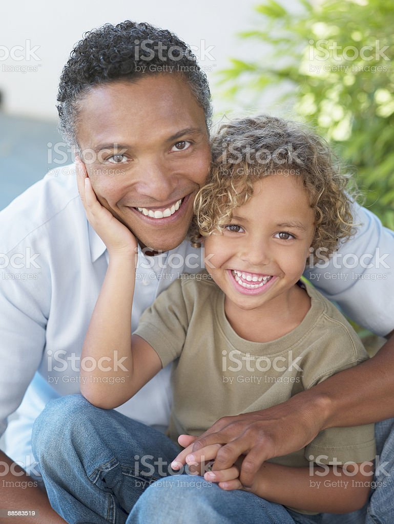 Portrait of father and son outdoors royalty-free stock photo