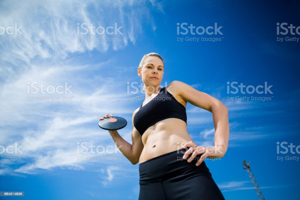 Portrait of female athlete holding a discus royalty-free stock photo