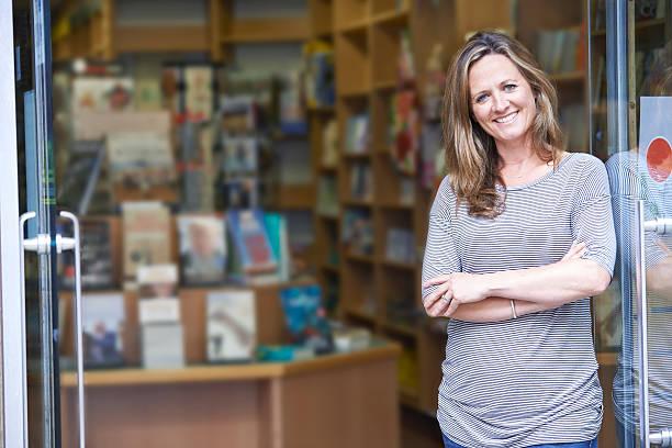 Portrait Of Female Bookshop Owner Outside Store stock photo