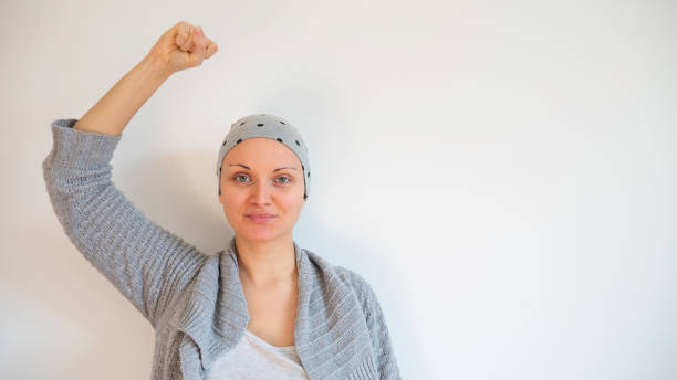 Portrait of female cancer survivor no white background. Happy cancer survivor after successful chemotherapy. Copy space for text. Portrait of female cancer survivor no white background. Happy cancer survivor after successful chemotherapy. Copy space for text. chemotherapy cancer stock pictures, royalty-free photos & images