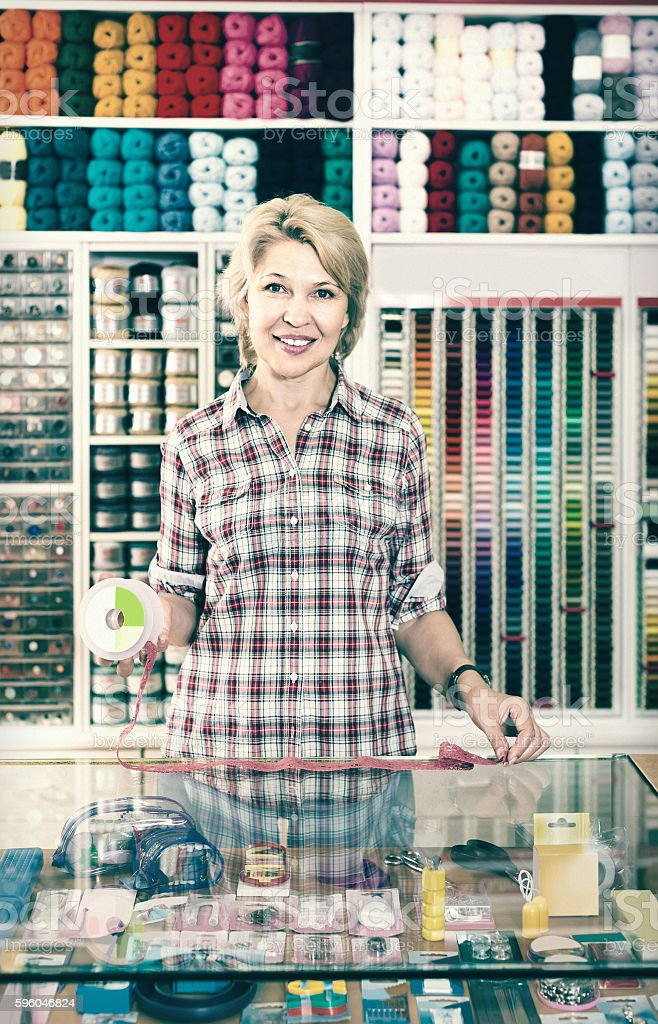 portrait of  female cashier standing at cash desk in embroidery royalty-free stock photo