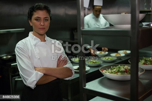istock Portrait of female chef standing with arms crossed 846625356