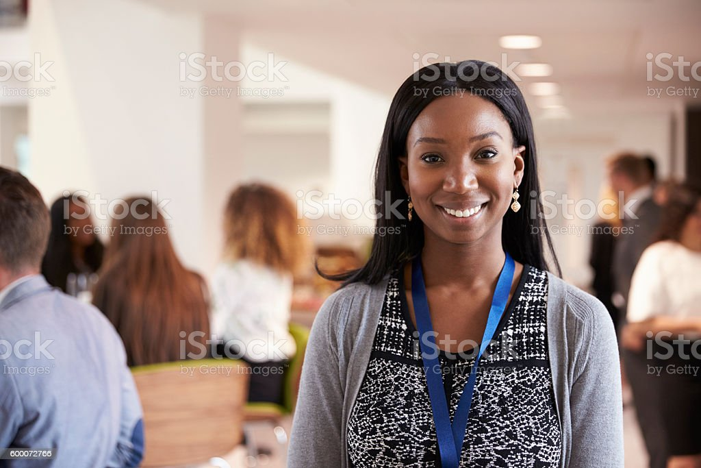 Portrait Of Female Delegate During Break At Conference stock photo