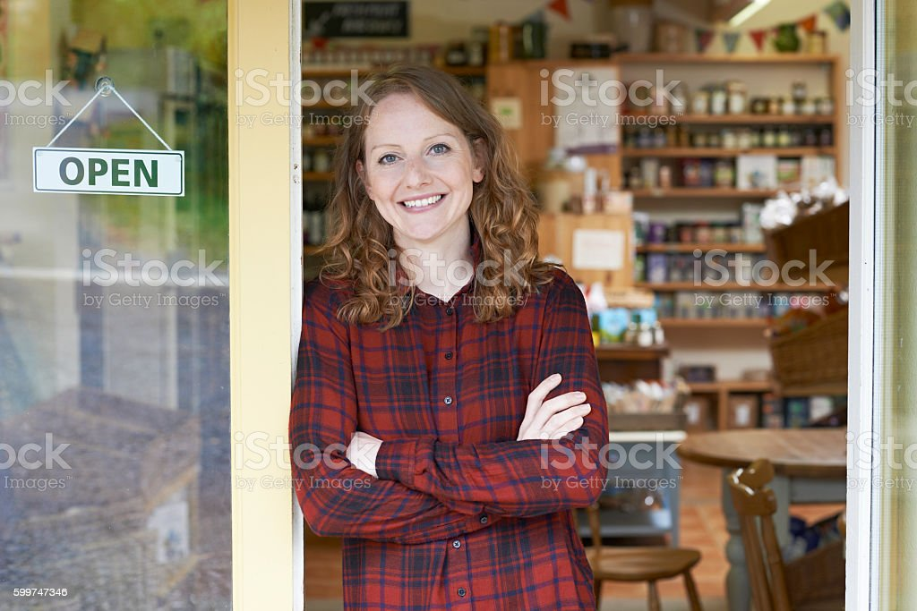 Portrait Of Female Delicatessen Owner Outside Store stock photo