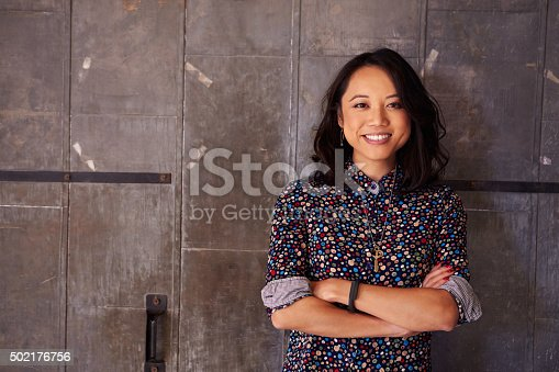 istock Portrait Of Female Designer Standing In Modern Office 502176756