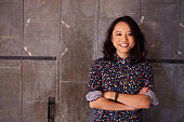 istock Portrait Of Female Designer Standing In Modern Office 502176756