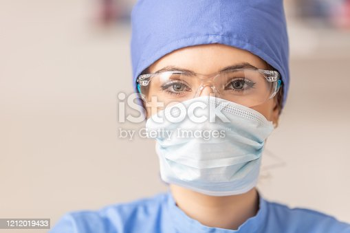 Portrait of female doctor in special surgical sterile protective clothing.