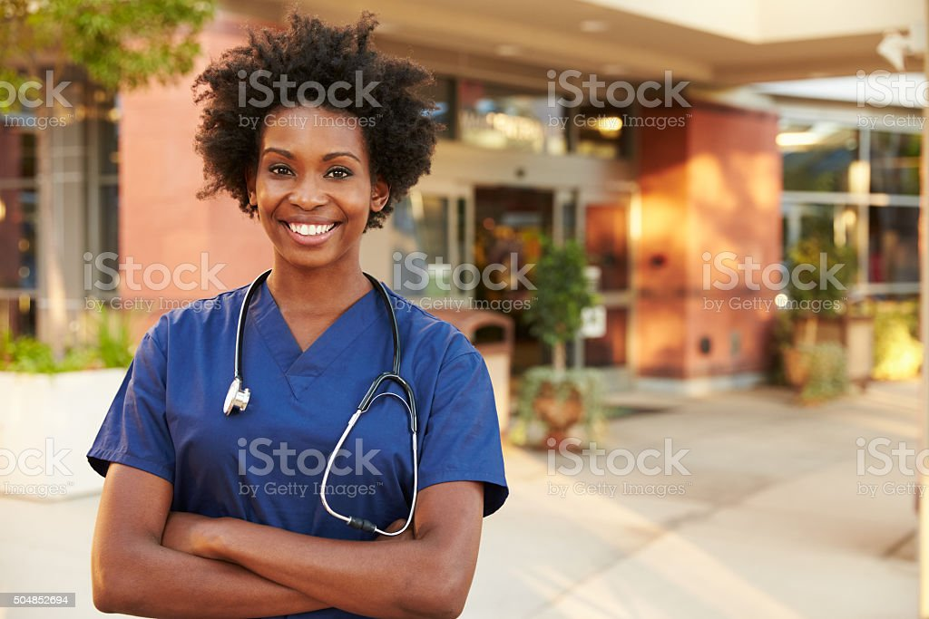 Portrait Of Female Doctor Standing Outside Hospital stock photo