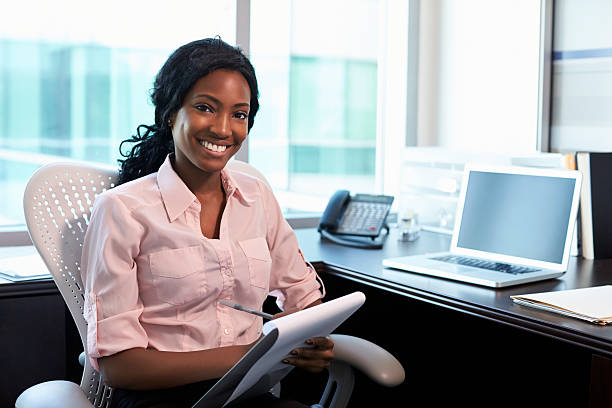 Portrait Of Female Doctor Working In Office stock photo