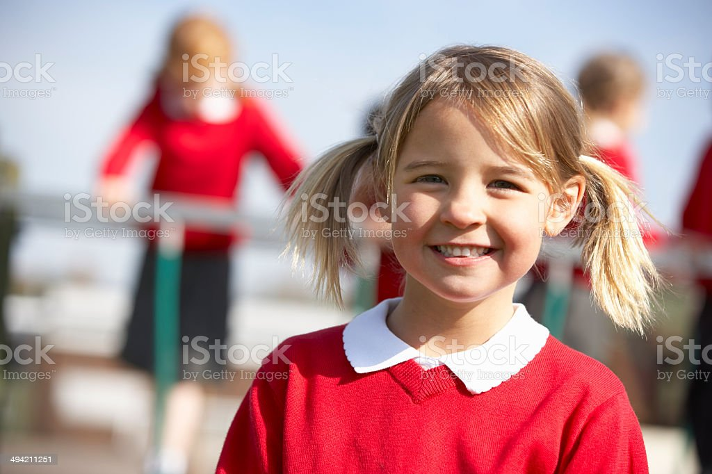 Portrait Of Female Elementary School Pupil In Playground royalty-free stock photo
