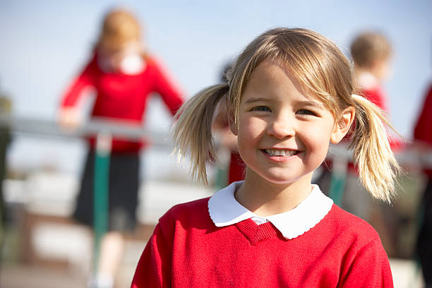 Portrait Of Female Elementary School Pupil In Playground stock photo
