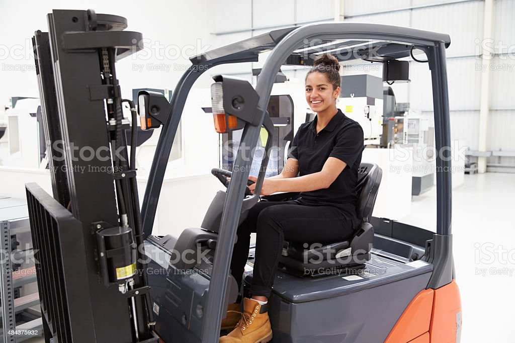 Portrait Of Female Fork Lift Truck Driver In Factory stock photo