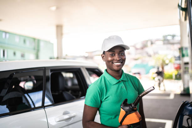 Portrait of female gas station attendant at work stock photo