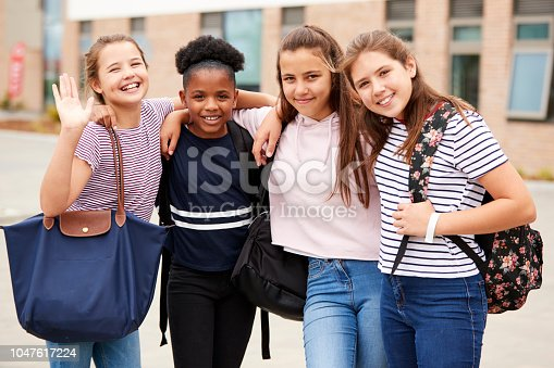 Portrait Of Female High School Student Friends Standing Outside School Buildings