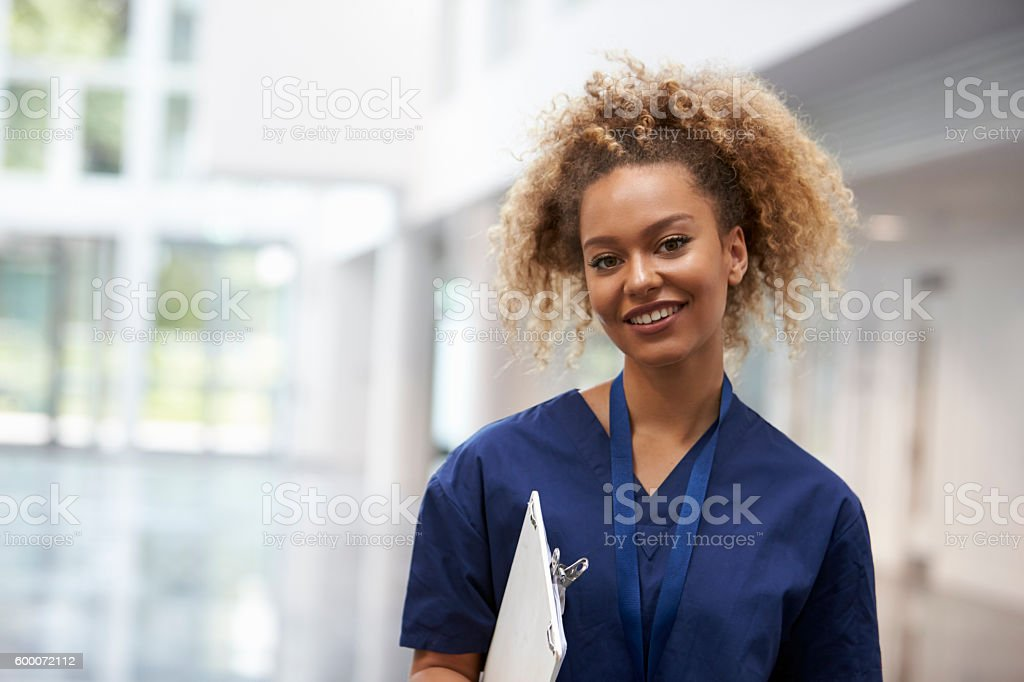 Portrait Of Female Nurse Wearing Scrubs In Hospital stock photo