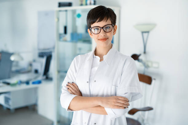 Portrait of female optometrist at eyesight medical clinic stock photo
