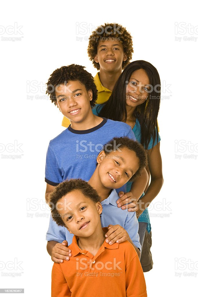 Portrait of female parent with four boys in a row royalty-free stock photo